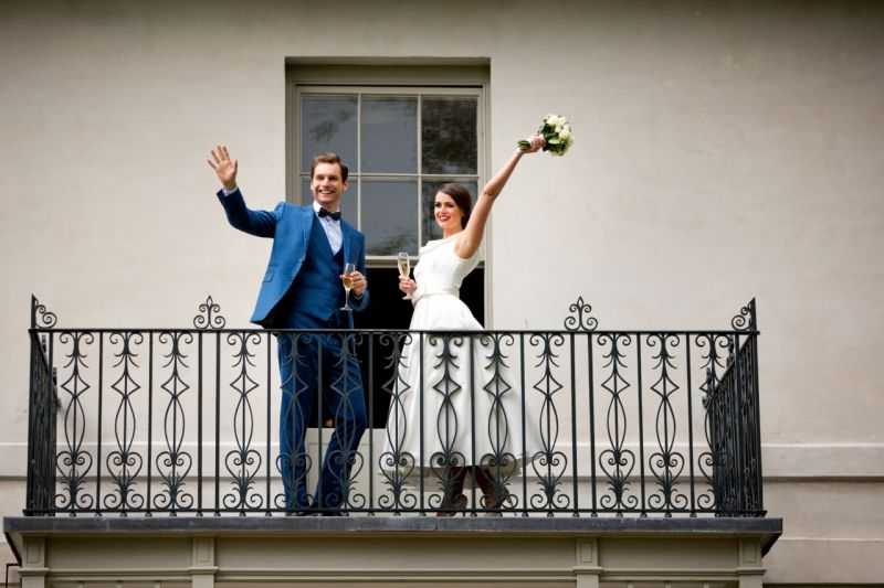 A Married Couple celebrating on the balcony at Cardigan Castle