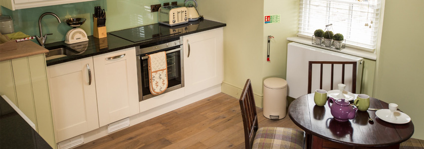 Inside the accommodation at Cardigan Castle, showing one of the self catering rooms.