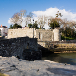 The outer walls of Cardigan Castle, a view over the river.