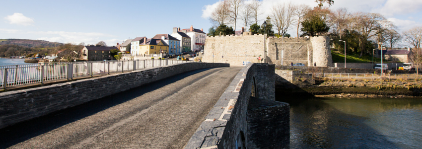 The outer walls of Cardigan castle, over the river.