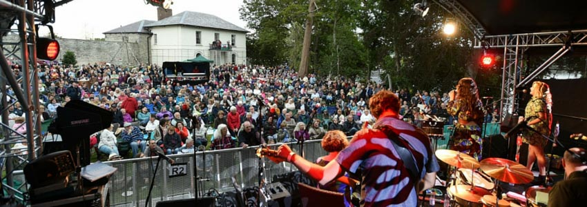 A event being held at cardigan castle, with a band playing on stage.