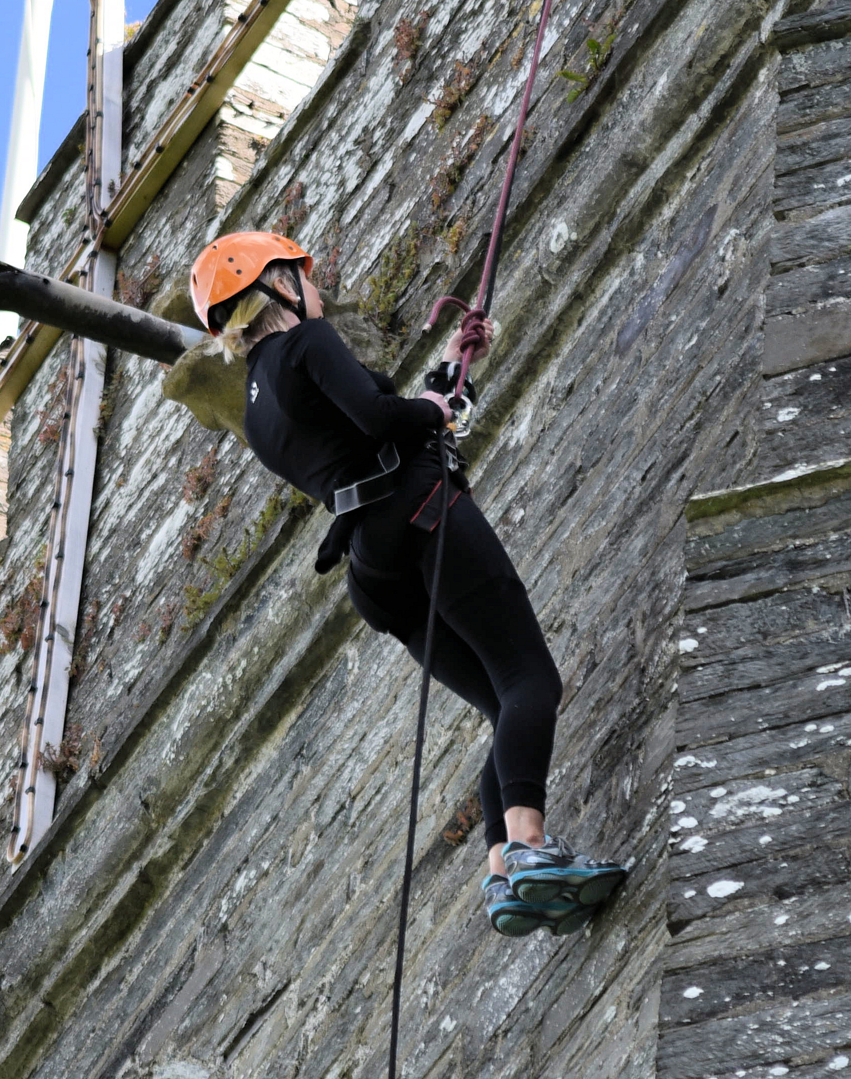 Abseiling down the walls of Cardigan castle.