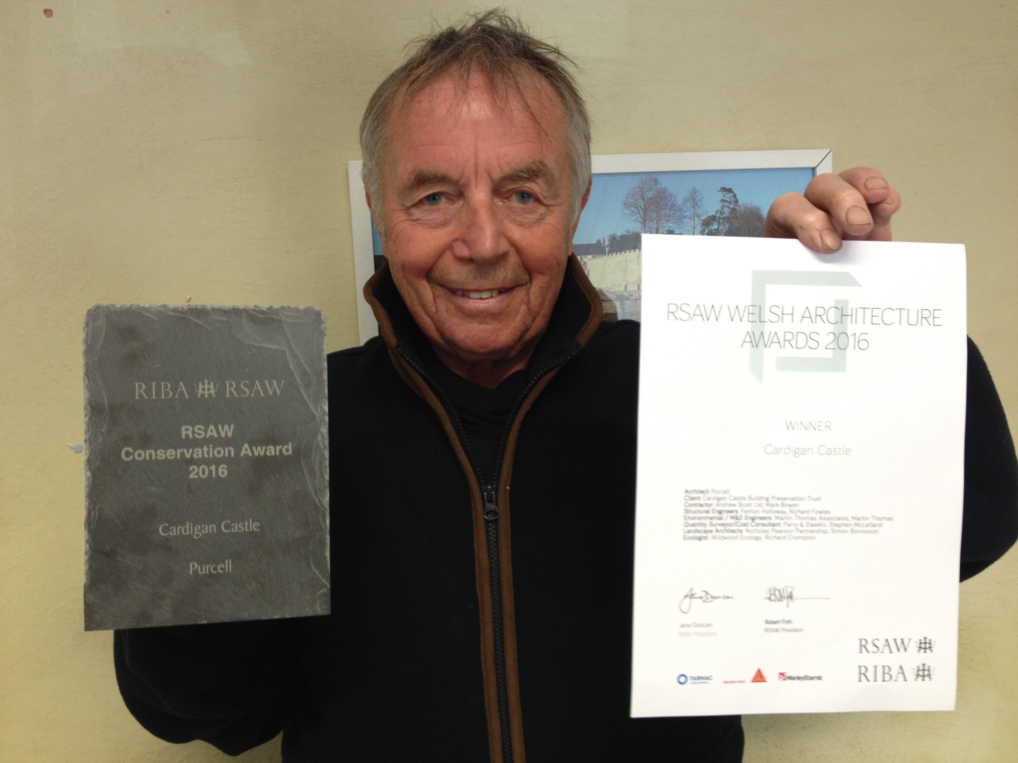 Trustee Dic Thomas with the award