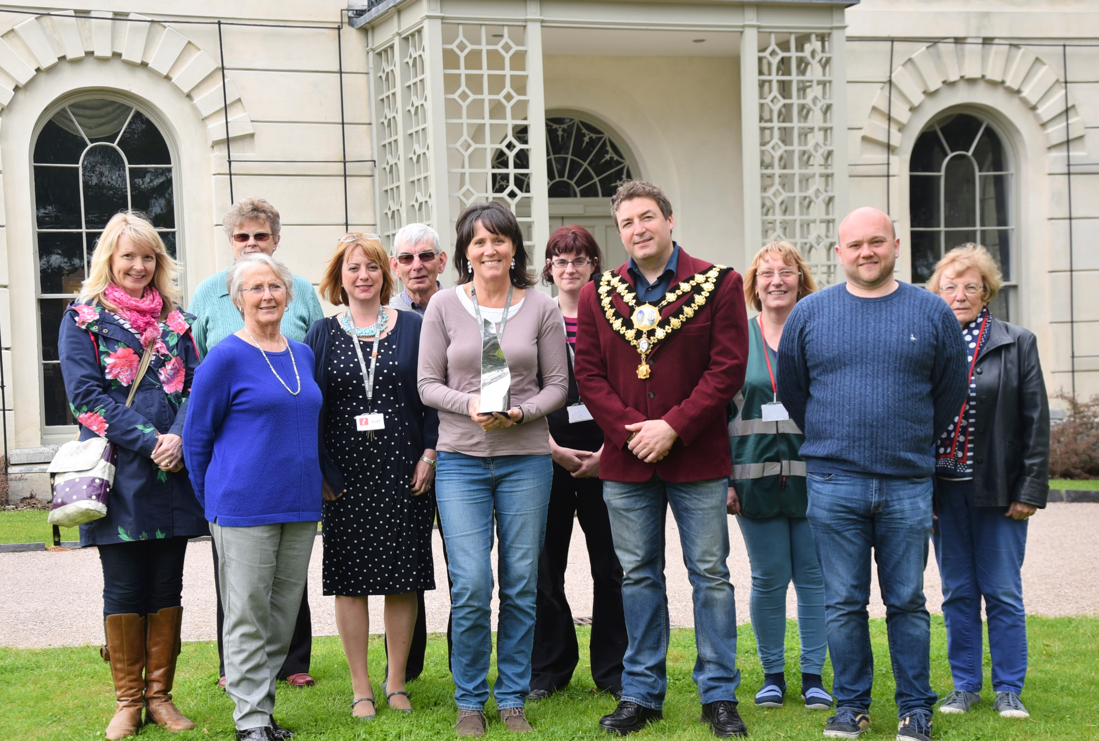Castle facilities officer Sue Lewis with the RICS awards, trustee and town mayor Cllr Clive Davies, trustees Arwyn Reed and Non Lewis, castle admin officer Sue Edwards, receptionist Alyson Cole, castle volunteers Beryl Davies, Huw Davies, Meifis Griffiths, Margaret Waller and Muriel Davies.