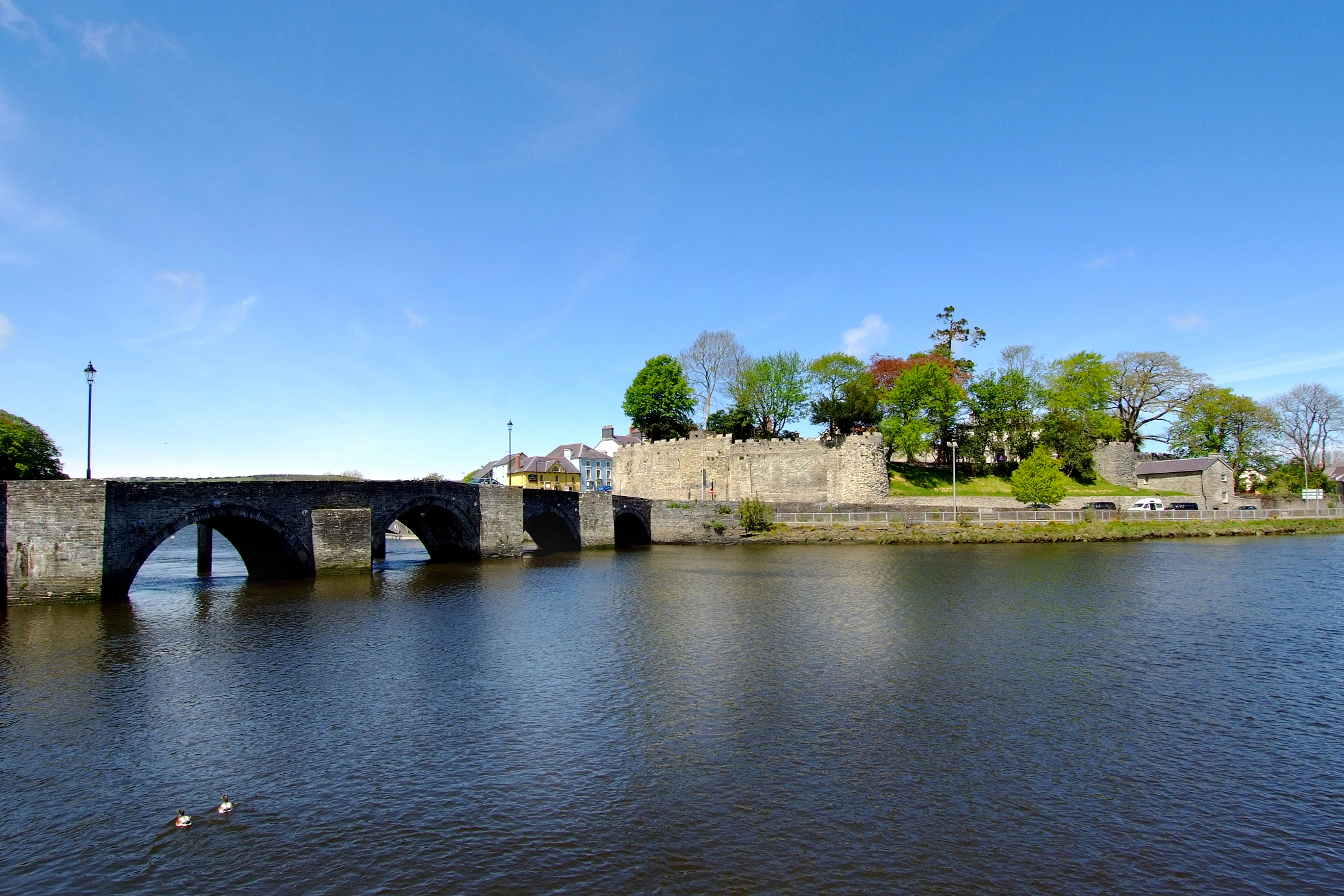 The river and Cardigan Castle on a sunny day.