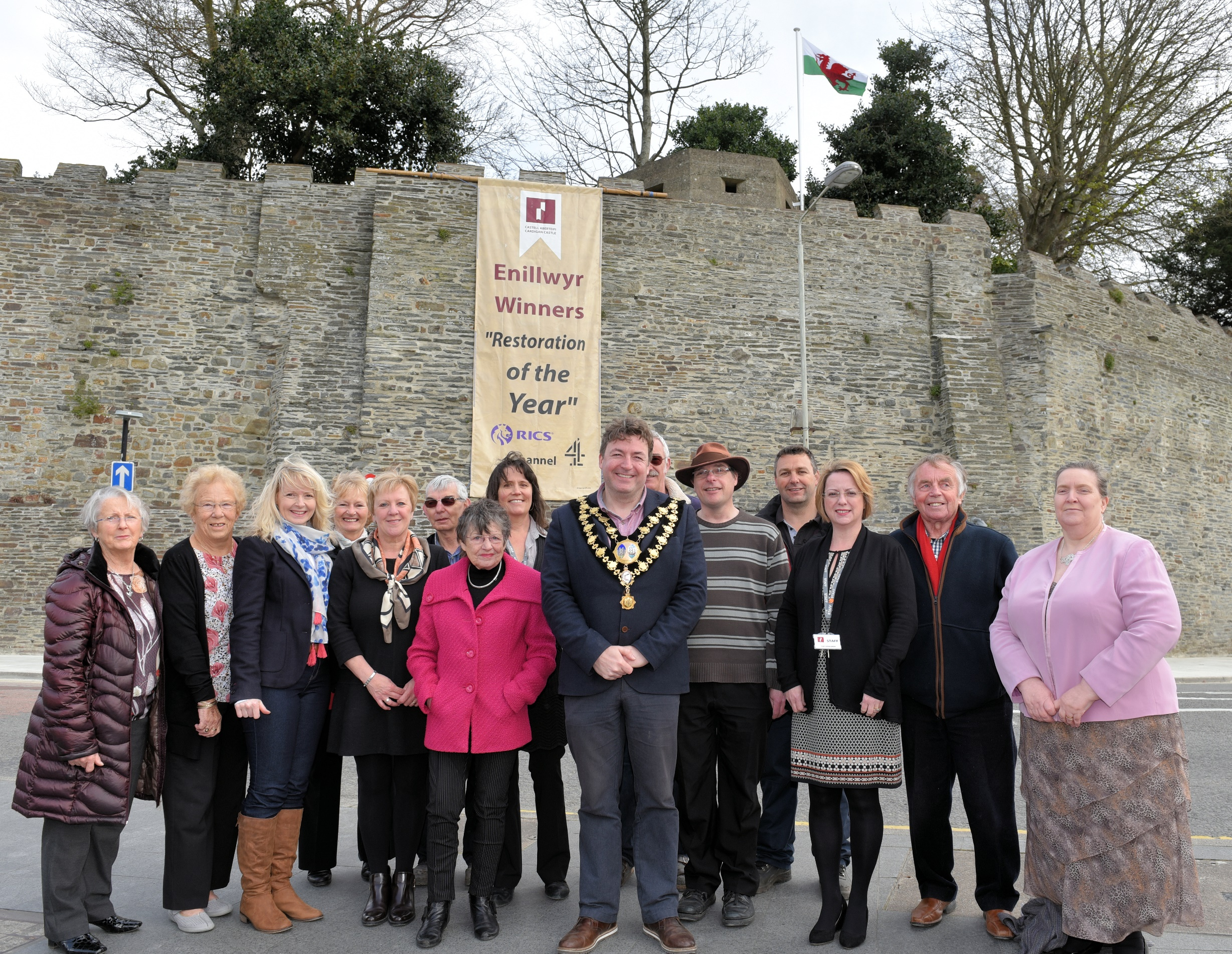 A collection of people unveiling the Restoration of the year Banner at Cardigan Castle.